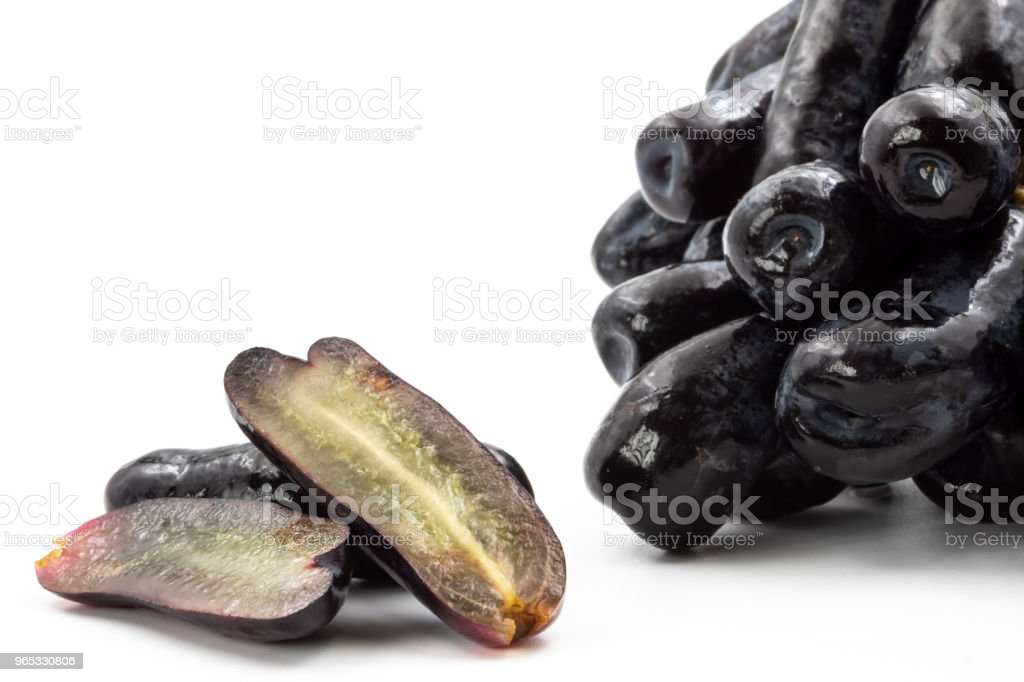 Black seedless moon drops grape or Witch fingers grape on white background royalty-free stock photo