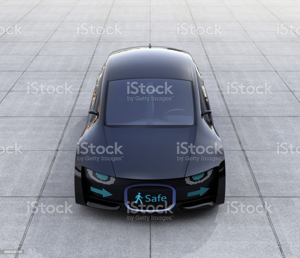 Black self-driving car parking on the ground stock photo