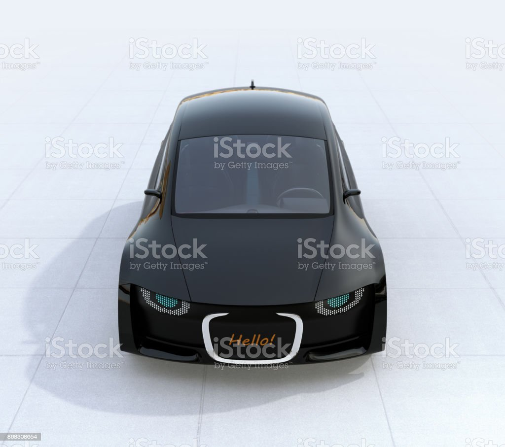 Black self-driving car's front grille showing digital signage for pedestrian. Concept for communication between autonomous car and pedestrian stock photo