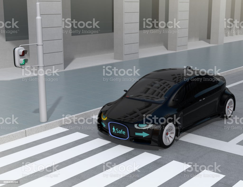 Black self-driving car's front grille showing digital signage for pedestrian stock photo