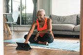 istock A black senior woman takes an online yoga class 1280247430