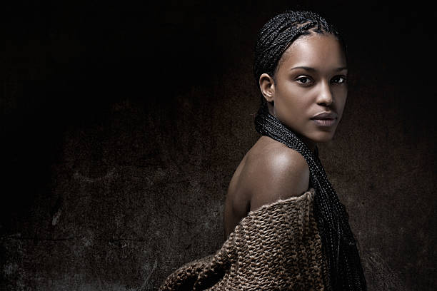 black sensual model with braided hair posing in studio stock photo