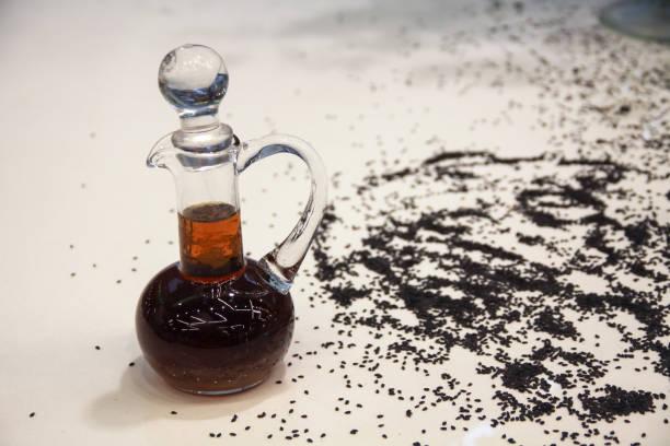 Black sesame oil product stock photo