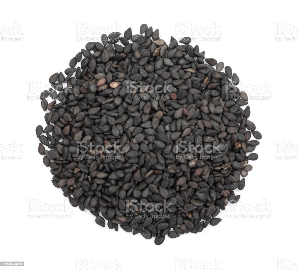 Black sesame seeds isolated on white background top view royalty-free stock photo