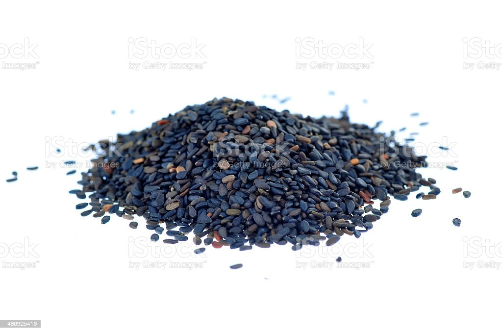 Black sesame seeds on a white background stock photo