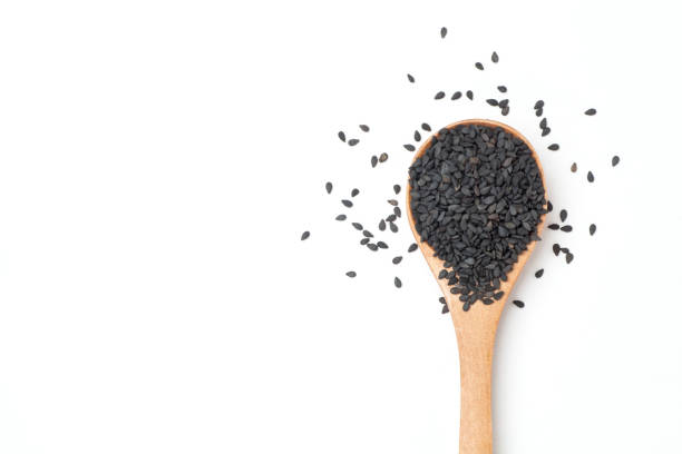black sesame seeds - sesame stock photos and pictures