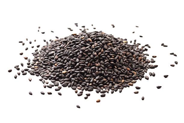 Black sesame seeds pile stock photo