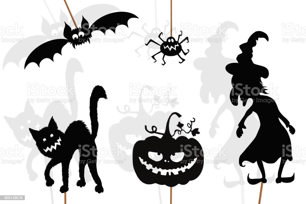 Black shadow puppets of Halloween creatures, isolated on white background. stock photo