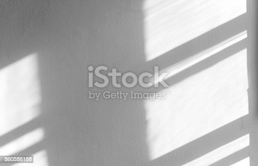 istock Black shadows on the concrete wall, abstract shadow, background for ideas 860586158
