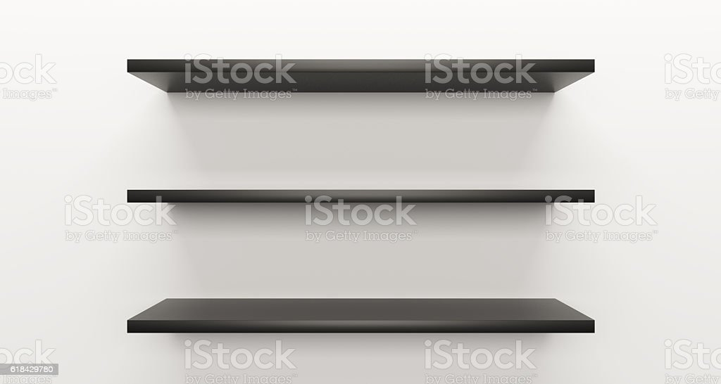 Black shelf on white wall – zdjęcie