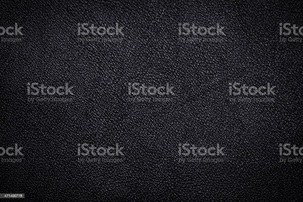 A black shiny leather textured background stock photo