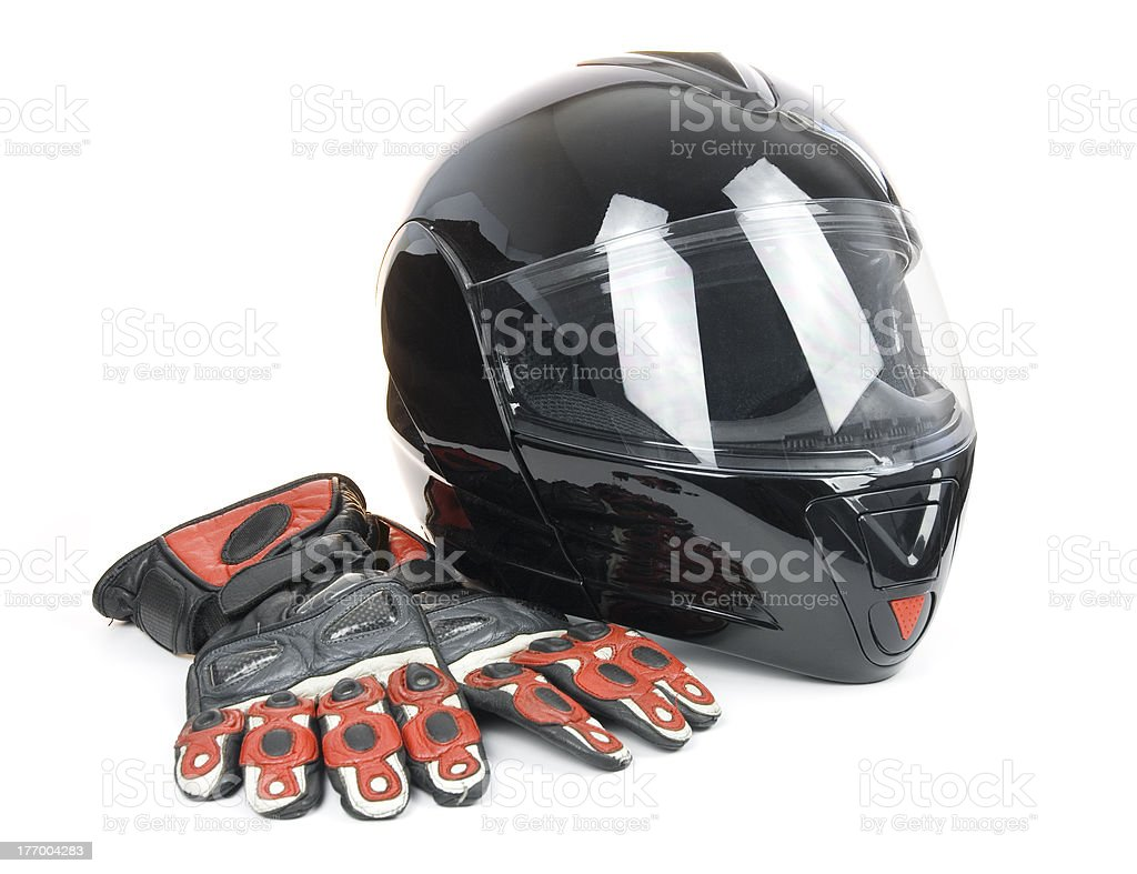 Black, shiny motorcycle helmet and leather biker gloves stock photo