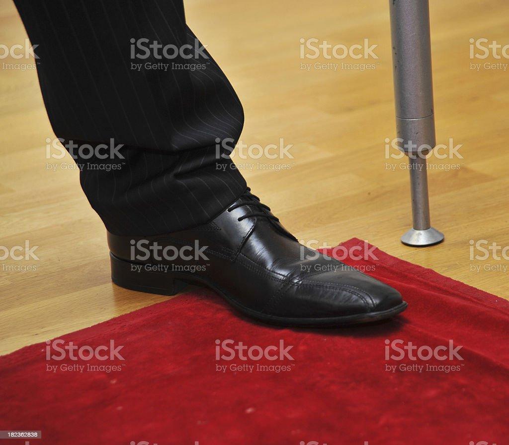 black shoe on red carpet royalty-free stock photo