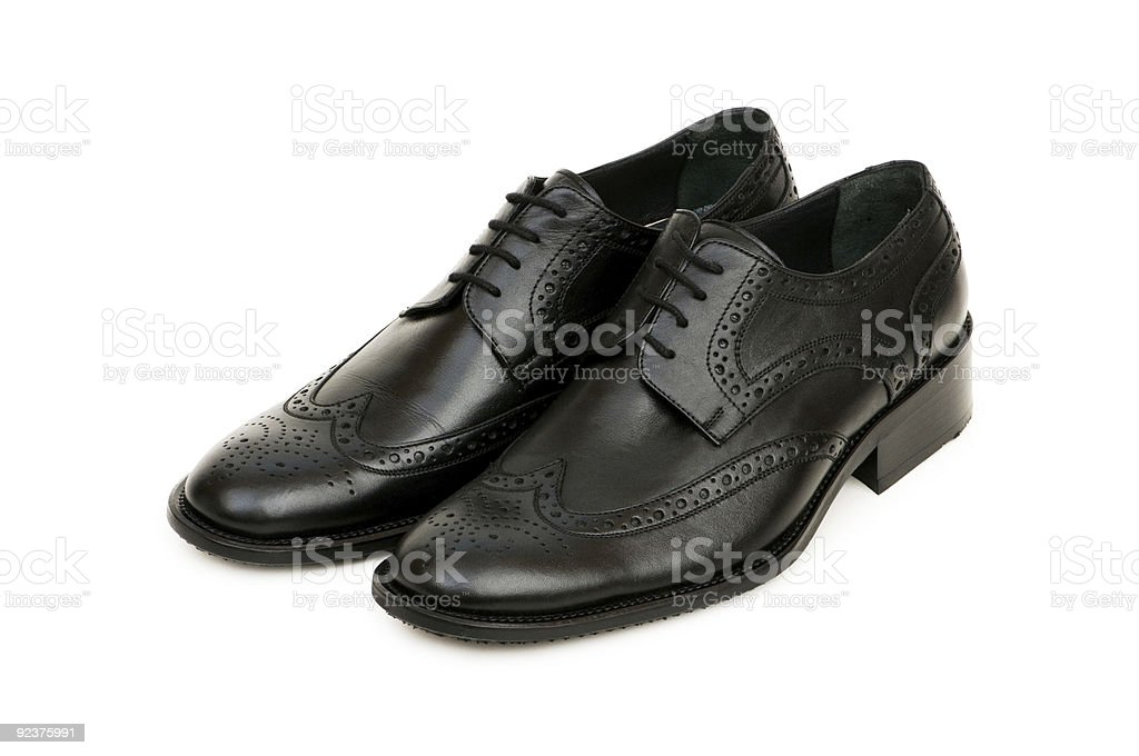 Black shoes isolated on the white background royalty-free stock photo