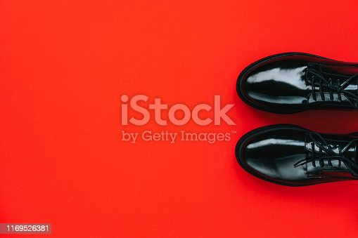 Black shoes on a red background. Black friday concept