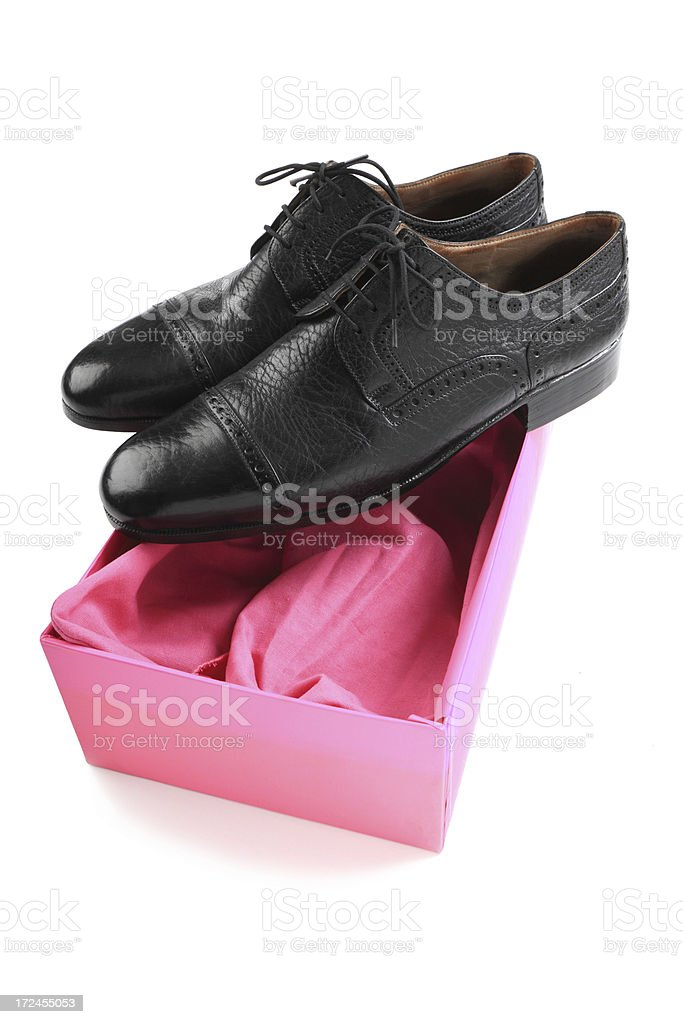 Black Shoes on pink box( Includes Clipping Path) royalty-free stock photo