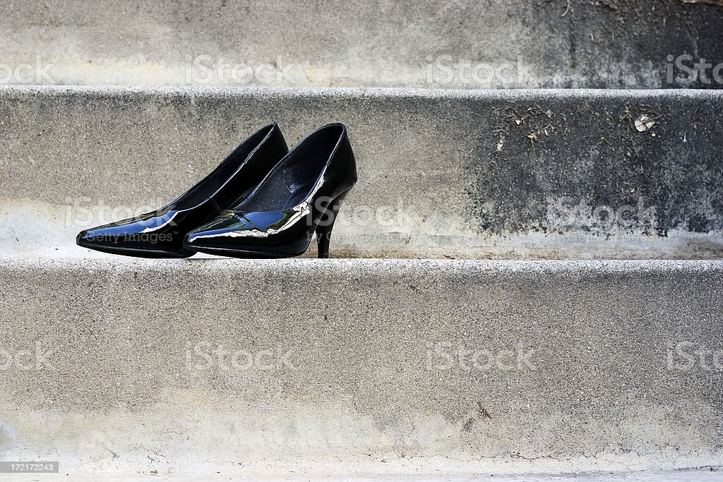 Black Shoes on Stone Steps royalty-free stock photo