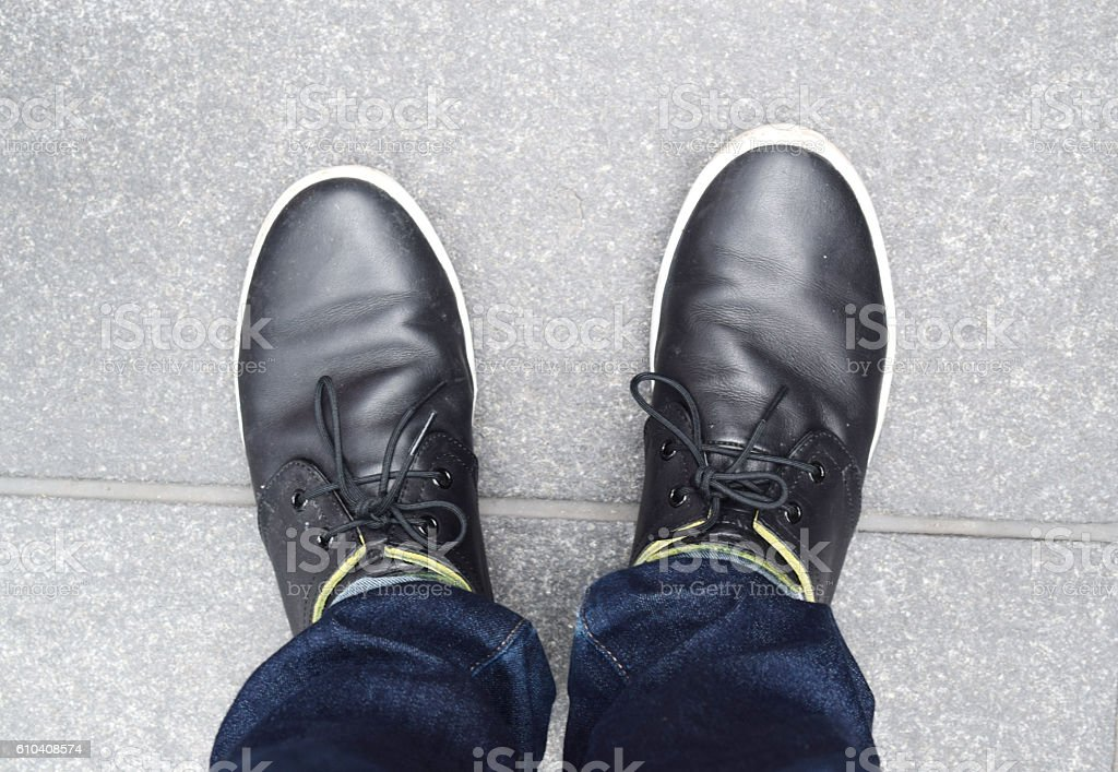 Black shoes on the ground stock photo