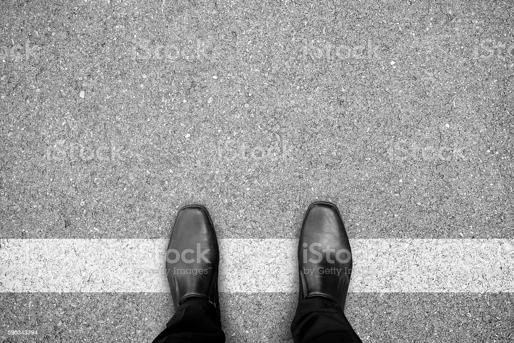 Black shoes standing on white line Lizenzfreies stock-foto
