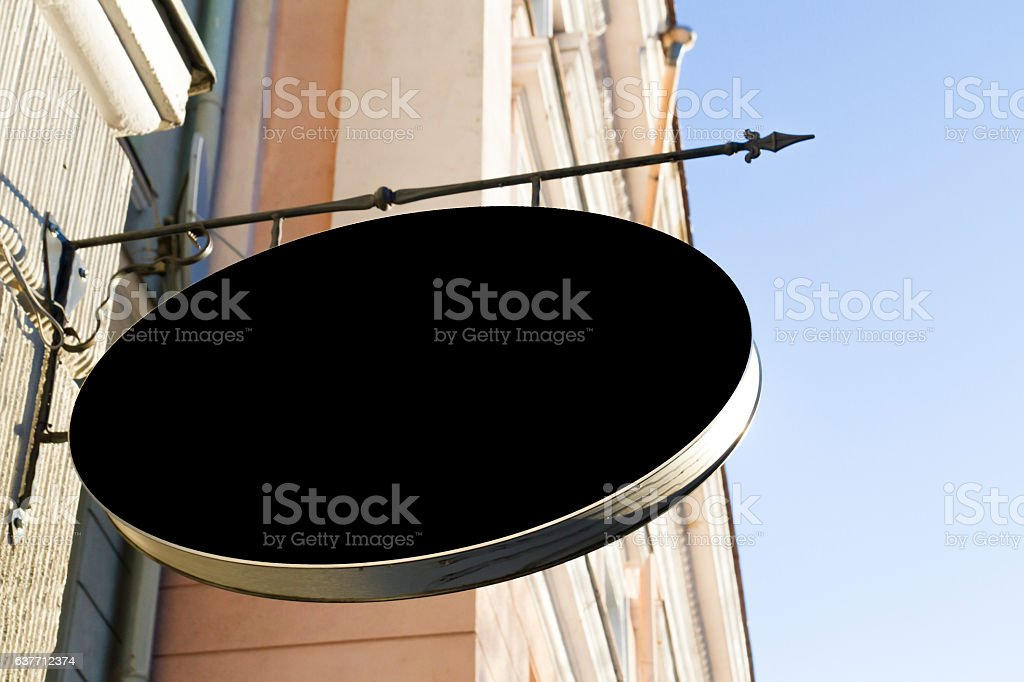 Black signboard on the wall. Mock up. stock photo