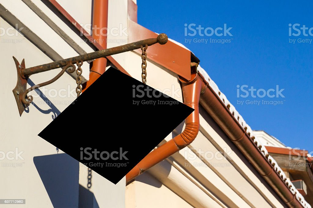 Black signboard on wall. Mock up stock photo