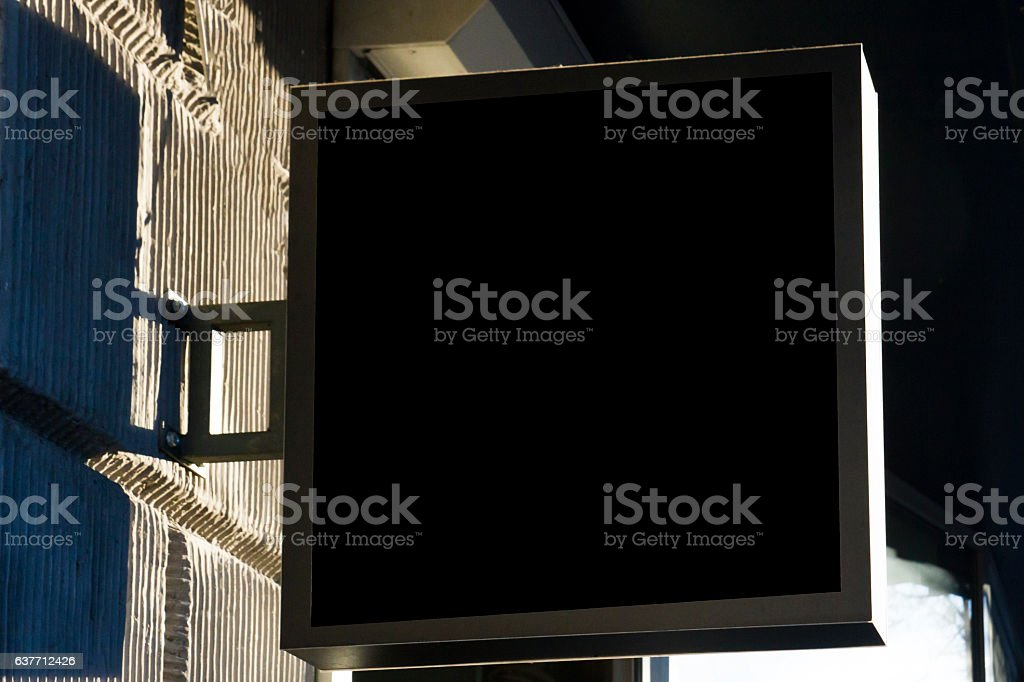 Black signboard on wall. Square shape mock up. stock photo