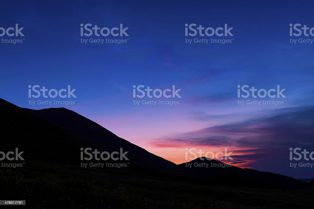 Black Silhouette Mountain at Sunset, Italy stock photo