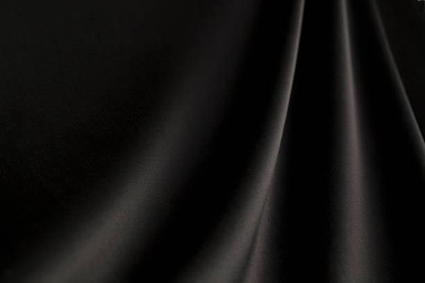 black silk fabric background with waves - satäng bildbanksfoton och bilder