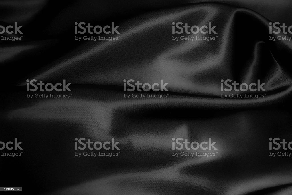 Black silky material with wrinkles in it royalty-free stock photo