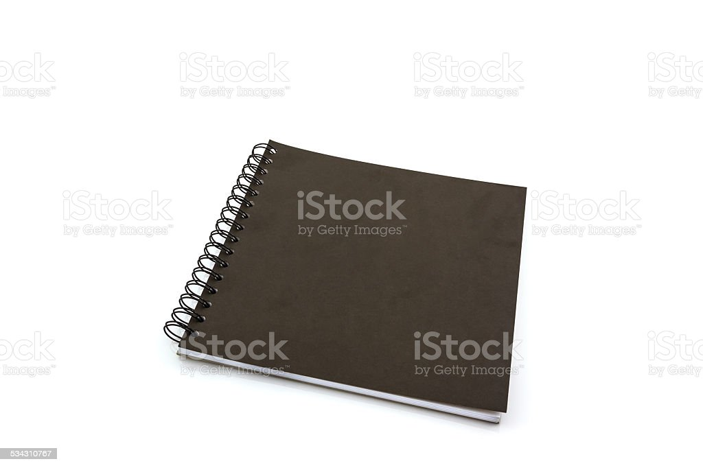 Black sketch book on white background. stock photo