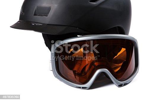 istock Black ski and snowboard helmet and glasses 497835260
