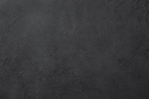 Black slate or stone texture background
