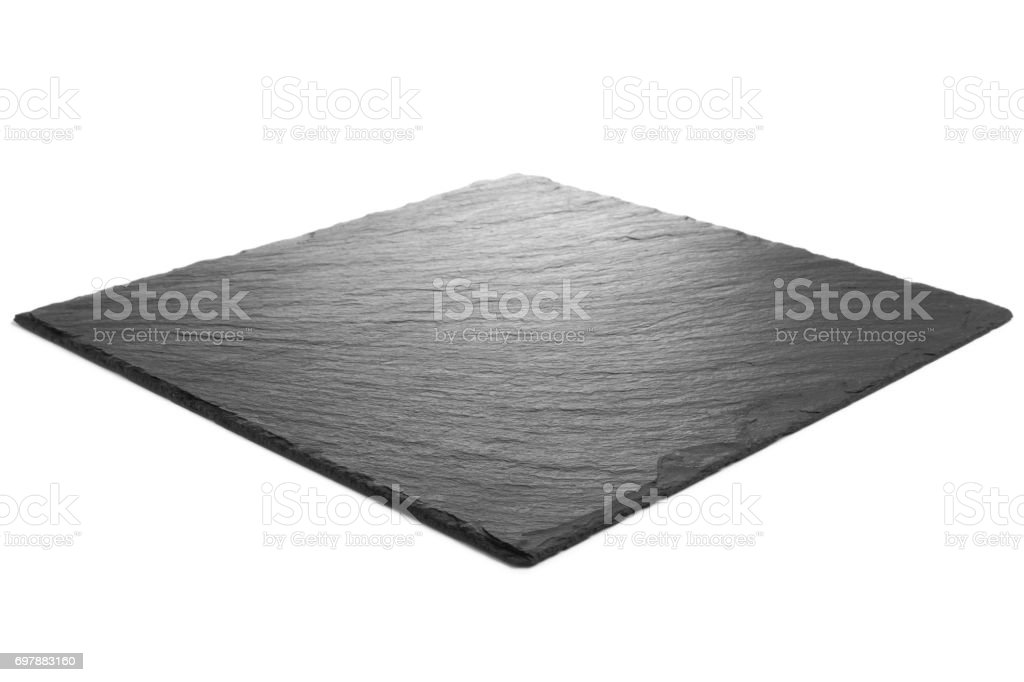 Black slate plate on white background stock photo