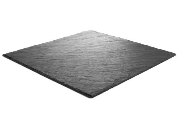 Black slate plate on white background stock photo