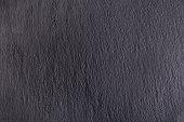 istock Black slate stone background 854304680