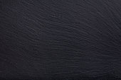 istock Black slate stone background 854304760