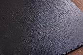 istock Black slate stone background 854915890