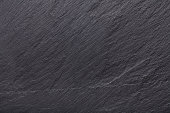 istock Black slate stone background 860137856
