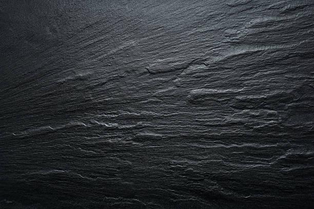 schwarze tafel texturierter hintergrund-stone-grunge-textur - bogen bauen stock-fotos und bilder
