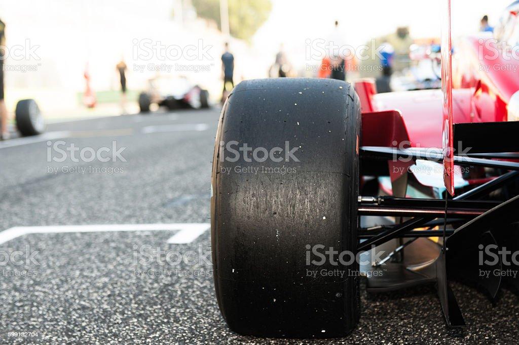 Black slick motorsport car tire close up stock photo