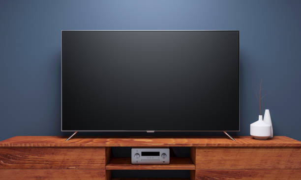 Black Smart Tv Mockup on wooden console stock photo