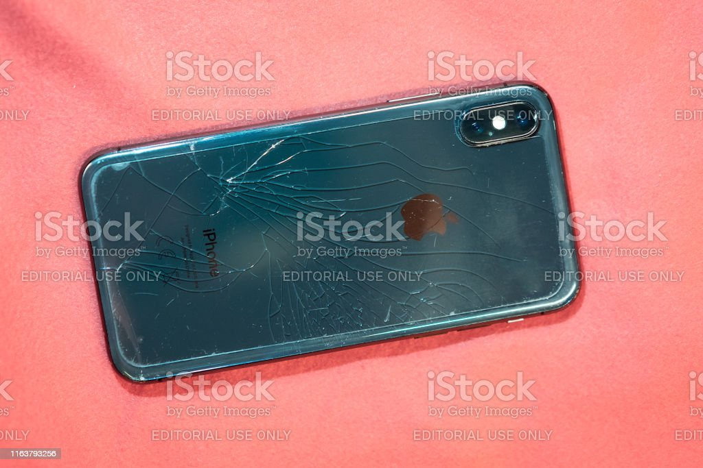 Black Smartphone Iphone X Broken Glass On The Back Cover Of The Phone Close Up Stock Photo - Download Image Now