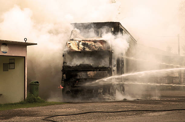 Black smoke on the road after a truck collision stock photo
