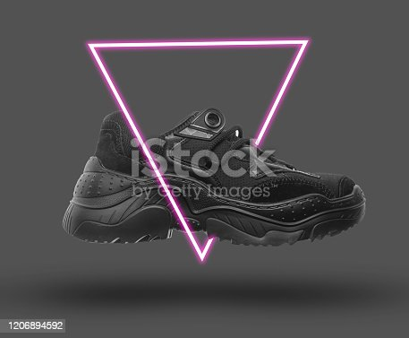 istock Black sneaker. 80's synth wave and retrowave glowing triangle futuristic aesthetics. Old fashioned abstraction concept 1206894592