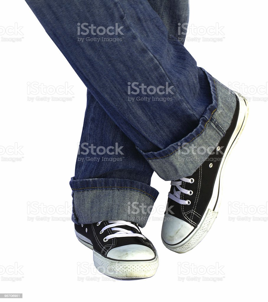 Black sneakers, posing, isolated stock photo
