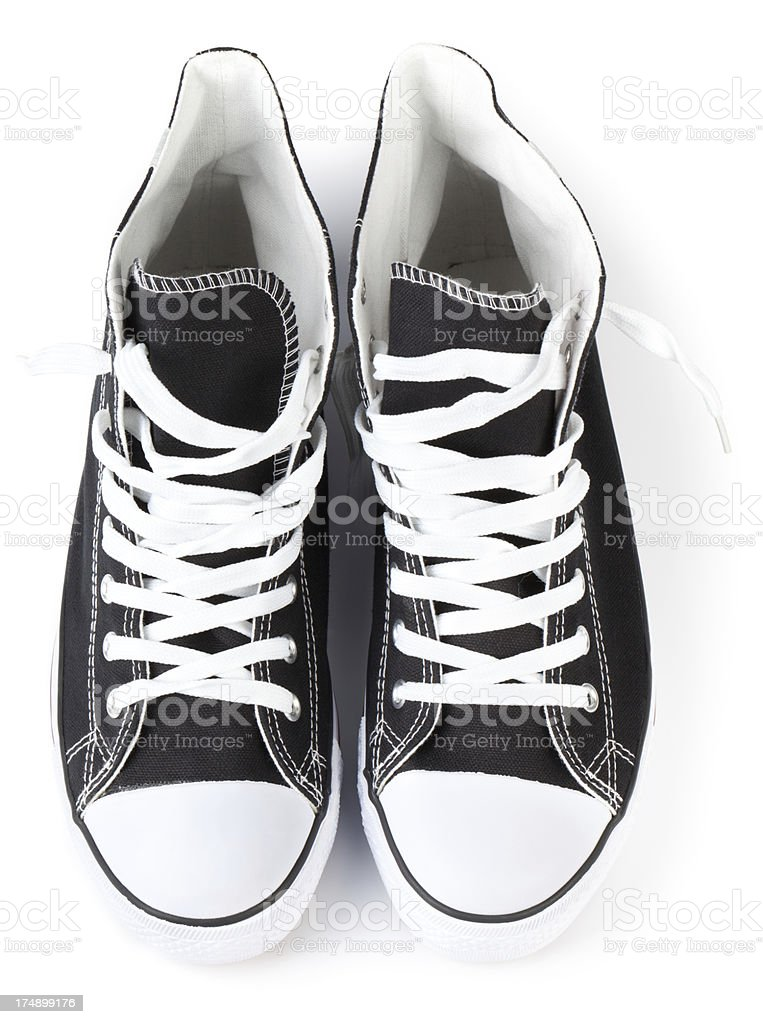 Black sneakers shot from above on a white background stock photo