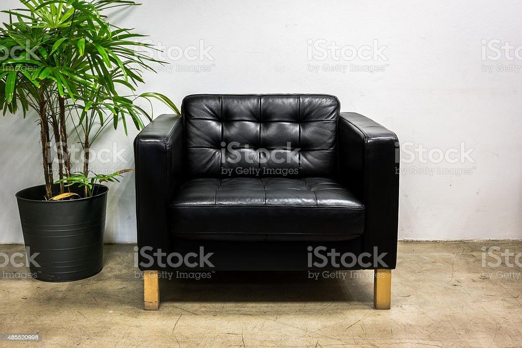Black sofa in office stock photo