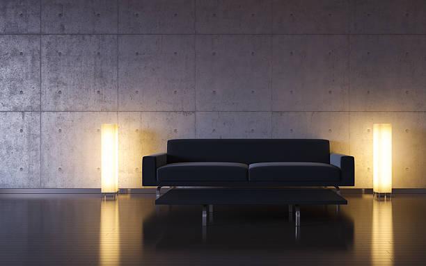 Black sofa, two lamps, dark room, empty wall stock photo