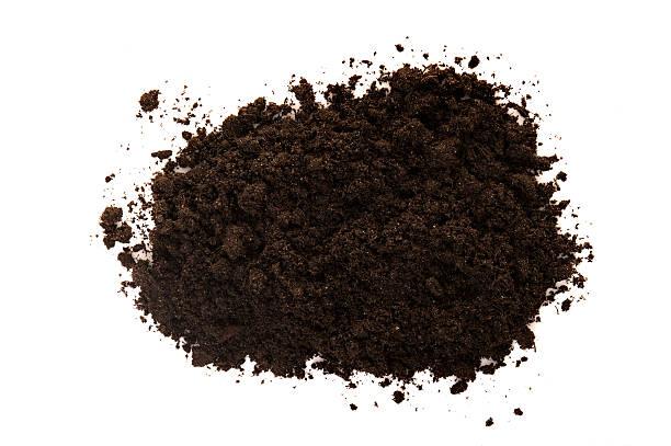 Black soil on white stock photo