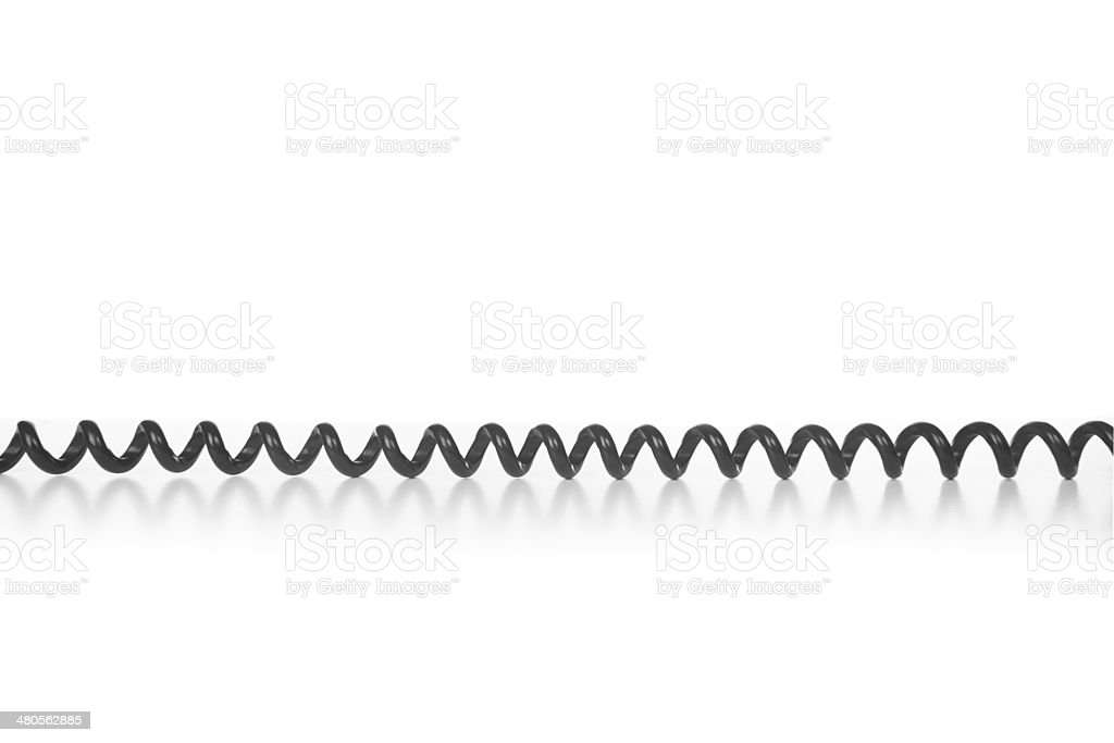 Black spiral telephone cable stock photo